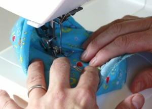 Continue sewing the full length of the zipper